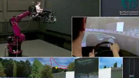 Roboterarm bewegt sich synchronisiert mit einem Formel-1-Spiel